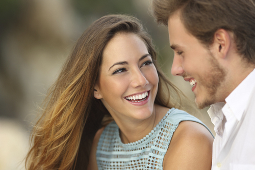 Invisalign® Couple smiling after receiving dental bonding